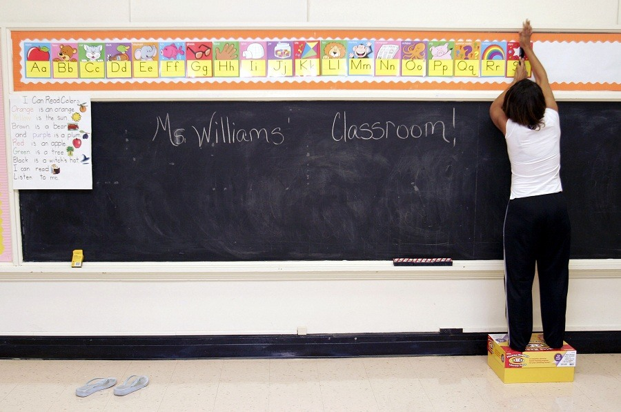 Ckaris Williams, a teacher and Hurricane Katrina evacuee, prepares her classroom