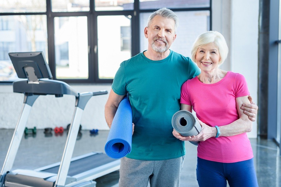 Old couple with yoga mat