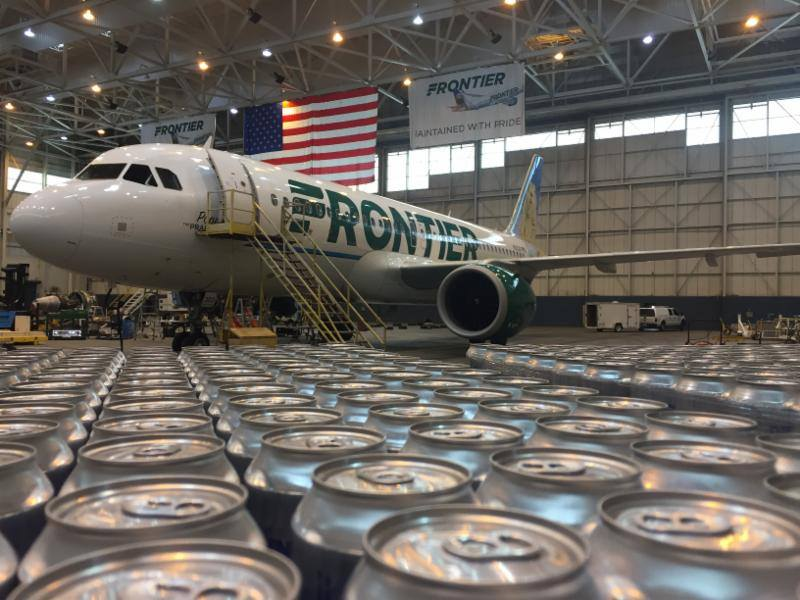 Frontier airlines plane with rows of beer cans