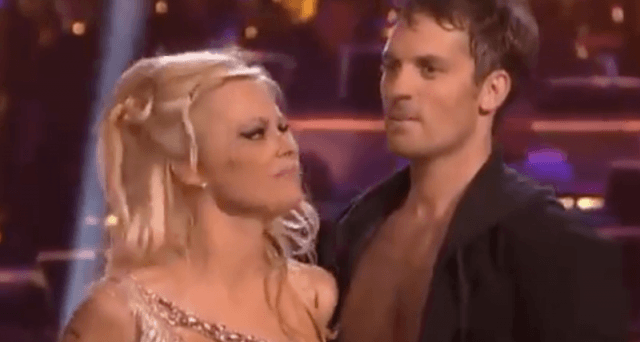 Pamela Anderson and Tristan MacManus listen to the judges score their routine.