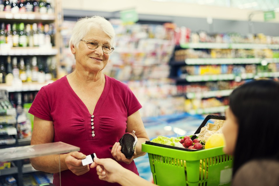 Older woman paying credit for purchases using her credit card