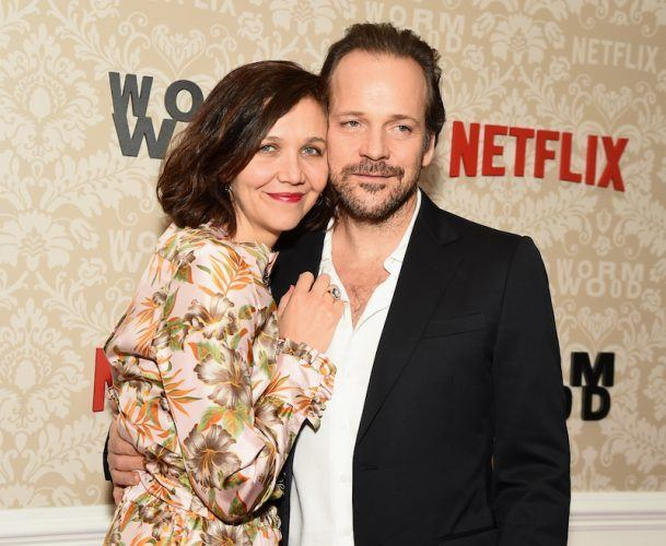 Maggie Gyllenhaal and Peter Sarsgaard posing for photographers.