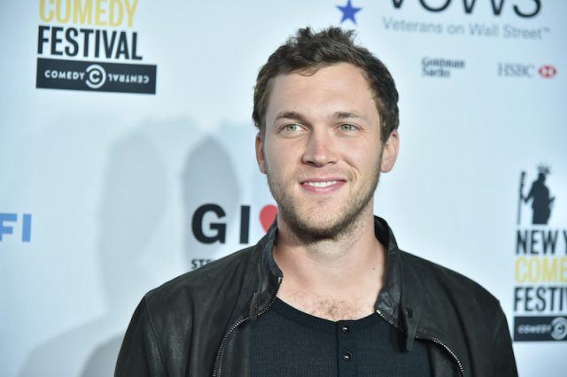 Phillip Phillips smiling on the red carpet.