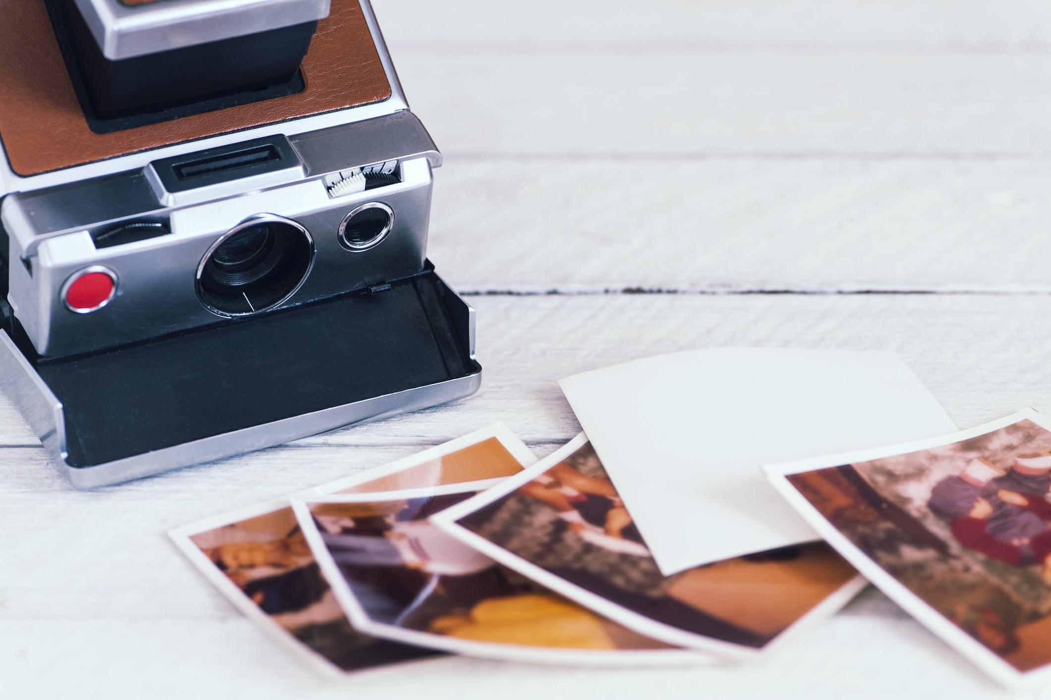 Polaroid camera with photos