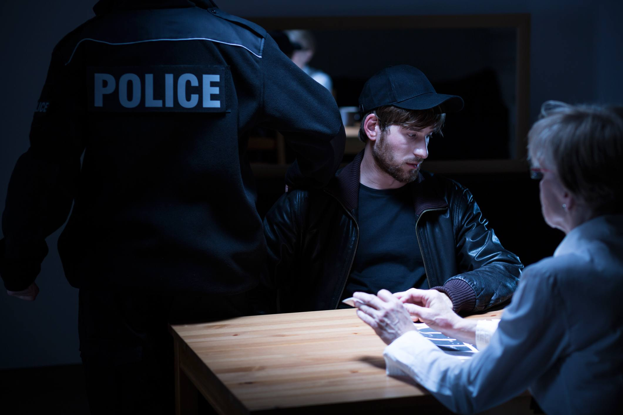 Policeman, suspect and female agent