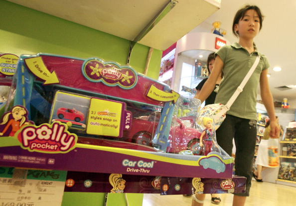 """A young girl walks past """"Polly Pocket"""" toys made by U.S. toy giant Matte"""