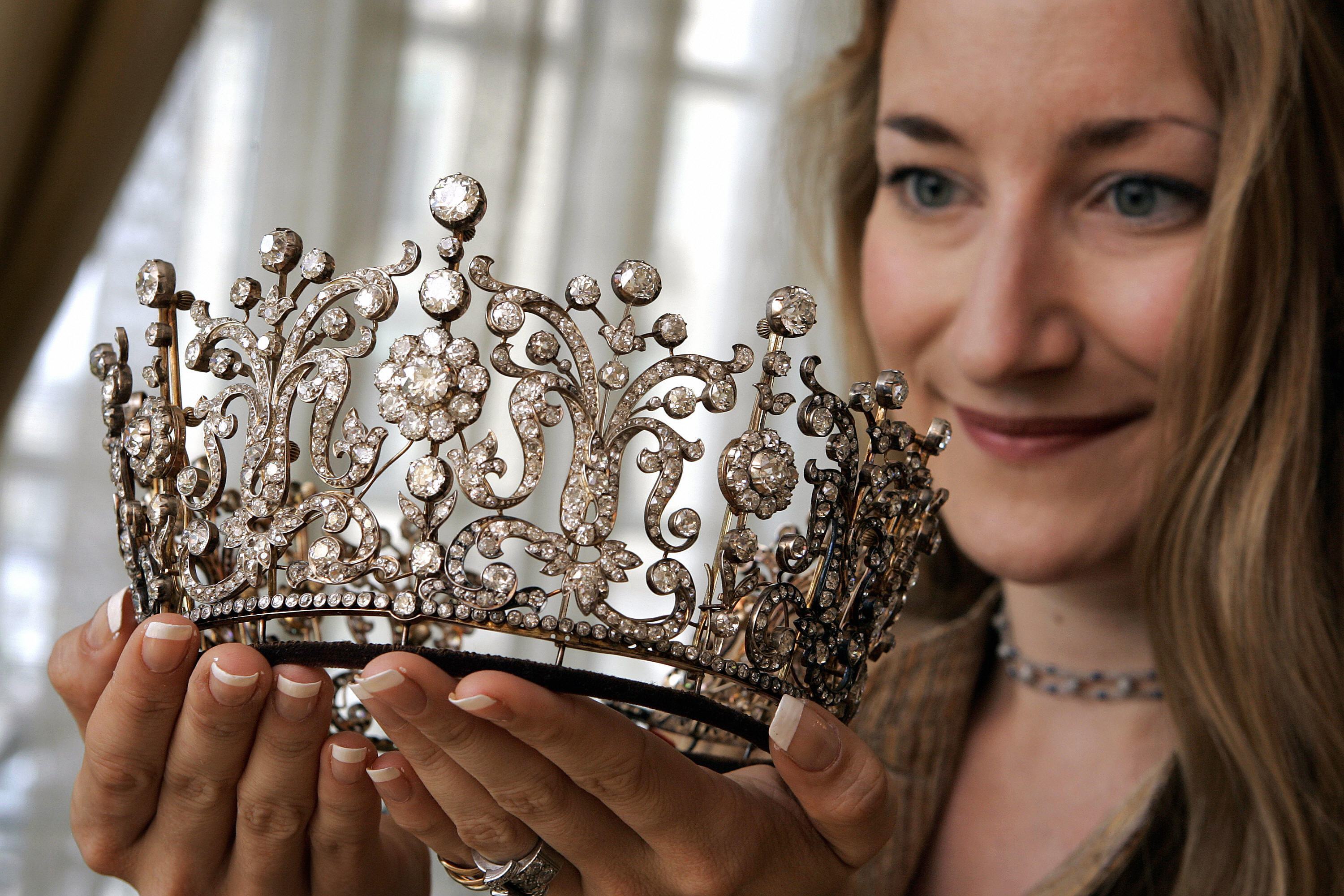 "Christie's Sale Specialist Helen Molesworth poses with the historic ""Poltimore Tiara"
