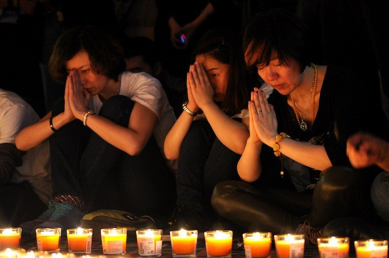 Chinese relatives of passengers on the missing Malaysia Airlines flight MH370 take part in a prayer service at the Metro Park Hotel in Beijing