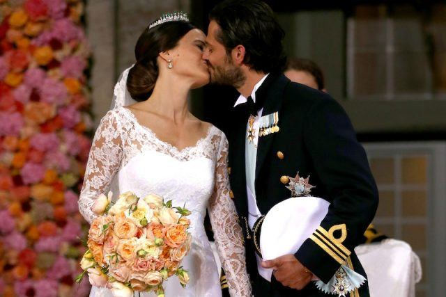 Prince Carl Philip and Princess Sofia of Sweden kiss on their wedding day.