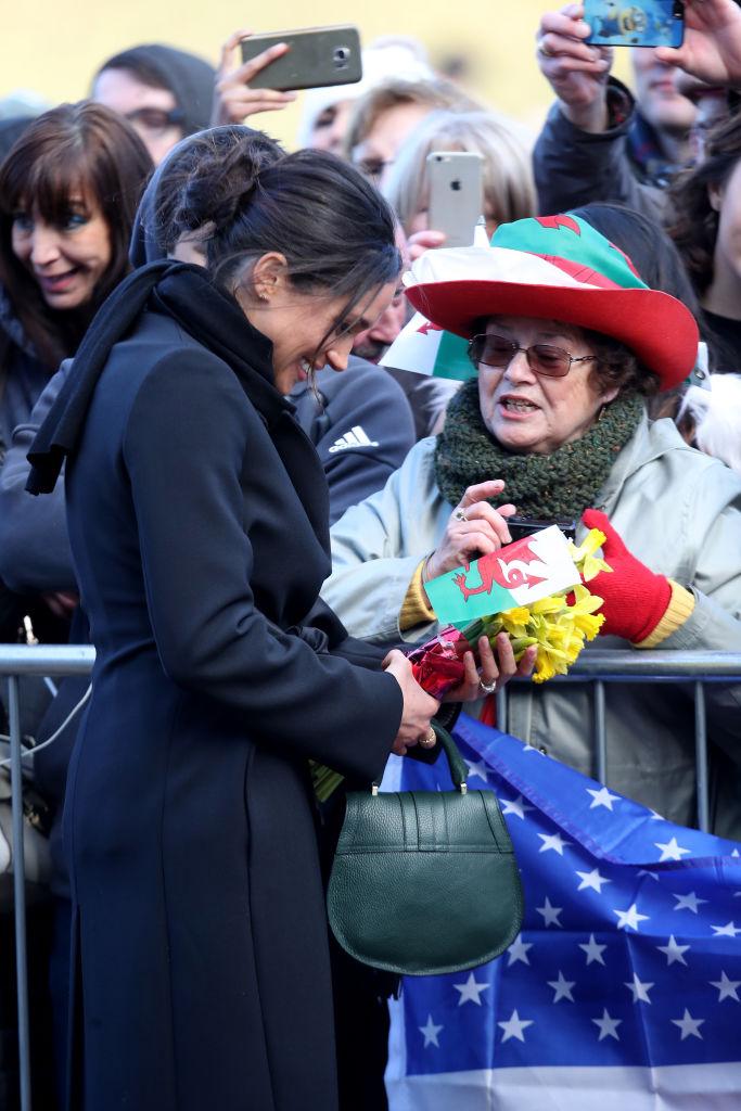 Meghan Markle greeting a fan
