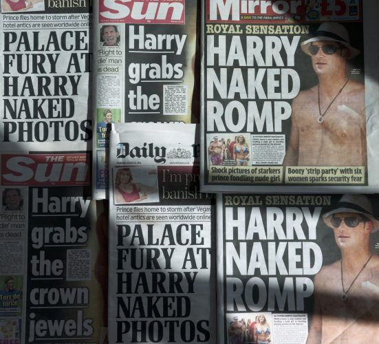 An arrangement of British daily newspapers photographed in London on August 23, 2012 shows the front-page headlines and stories regarding nude pictures of Britain's Prince Harry
