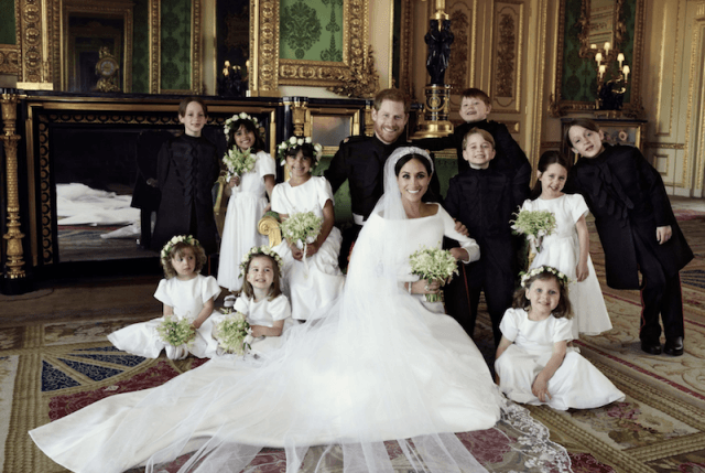 Prince Harry and Meghan Markle posing with their pageboys and bridesmaids.