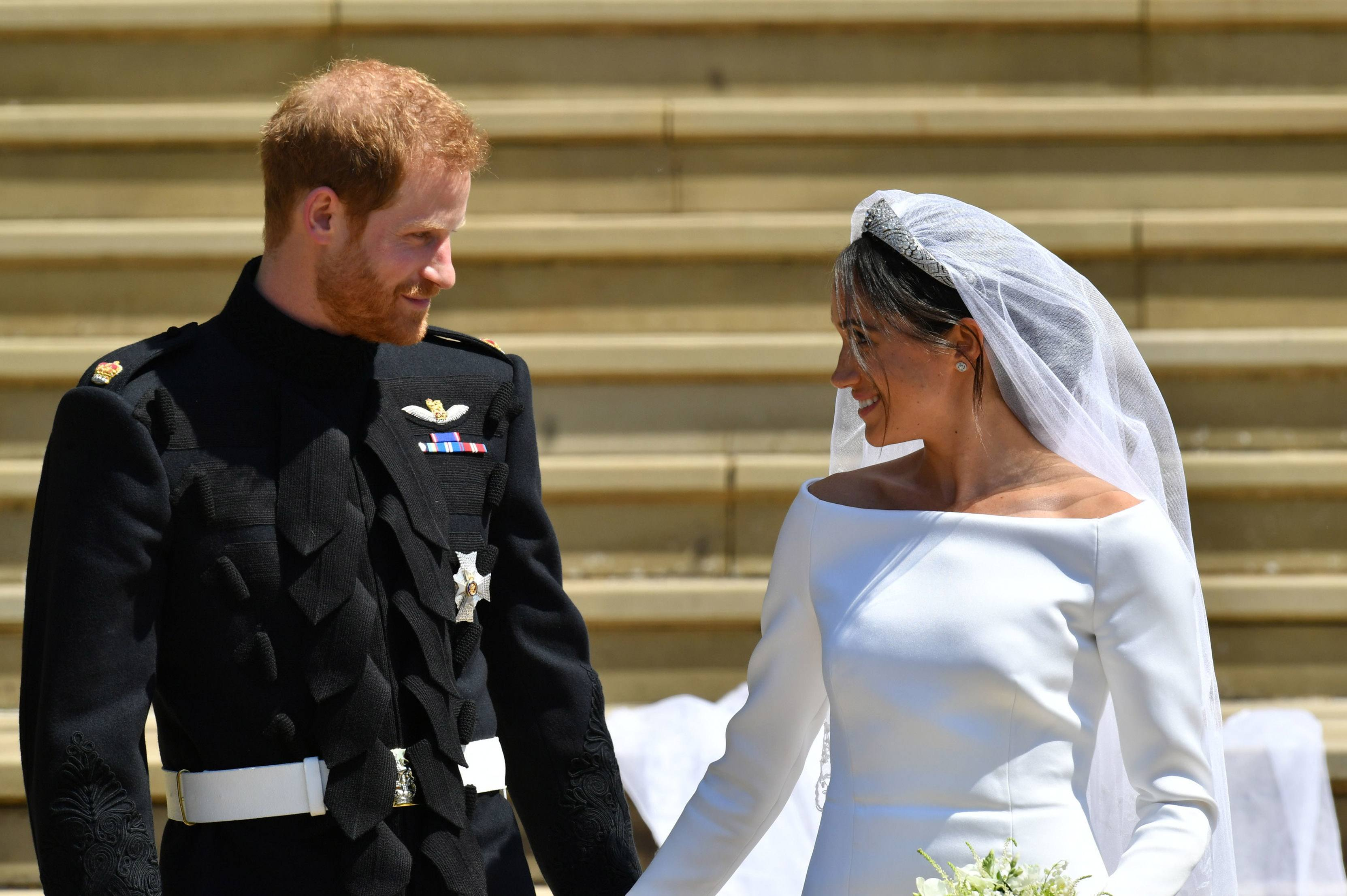 WINDSOR, UNITED KINGDOM - MAY 19: Prince Harry and Meghan Markle walk down the steps of St George's Chapel after their wedding in St George's Chapel at Windsor Castle on May 19, 2018 in Windsor, England. (Photo by Ben Birchall - WPA Pool/Getty Images)