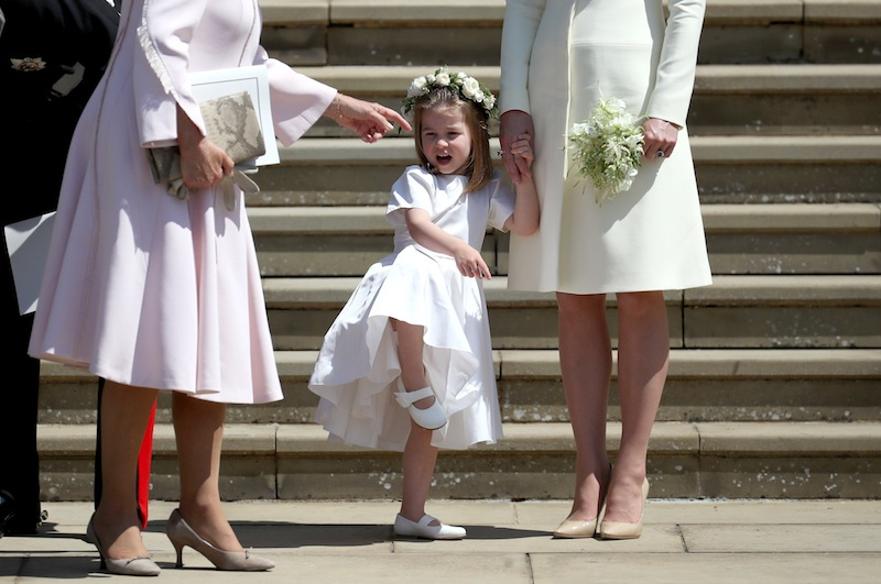 Princess Charlotte of Cambridge stands on the steps with her mother Catherine, Duchess of Cambridge