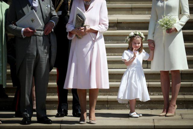 Princess Charlotte waving to the public.