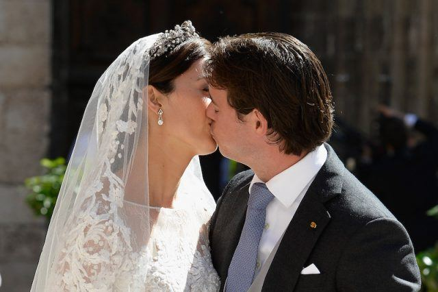 Princess Claire Of Luxembourg and Prince Felix Of Luxembourg kiss as they depart their wedding ceremony at the Basilique Sainte Marie-Madeleine.