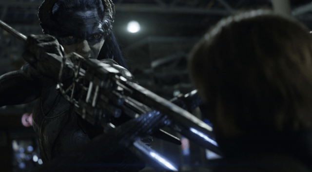 Proxima Midnight aiming a weapon.