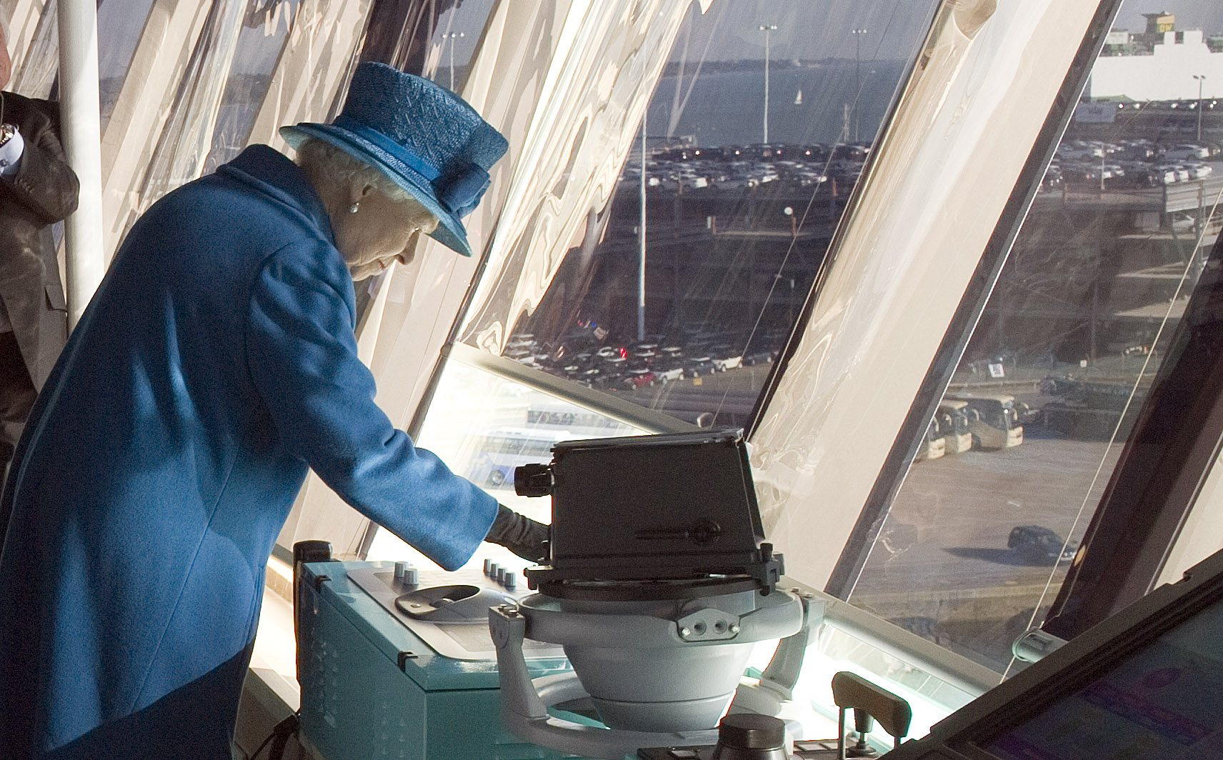 Queen Elizabeth II presses the ship's siren during a tour of the Cunard's new cruise-liner Queen Elizabeth II