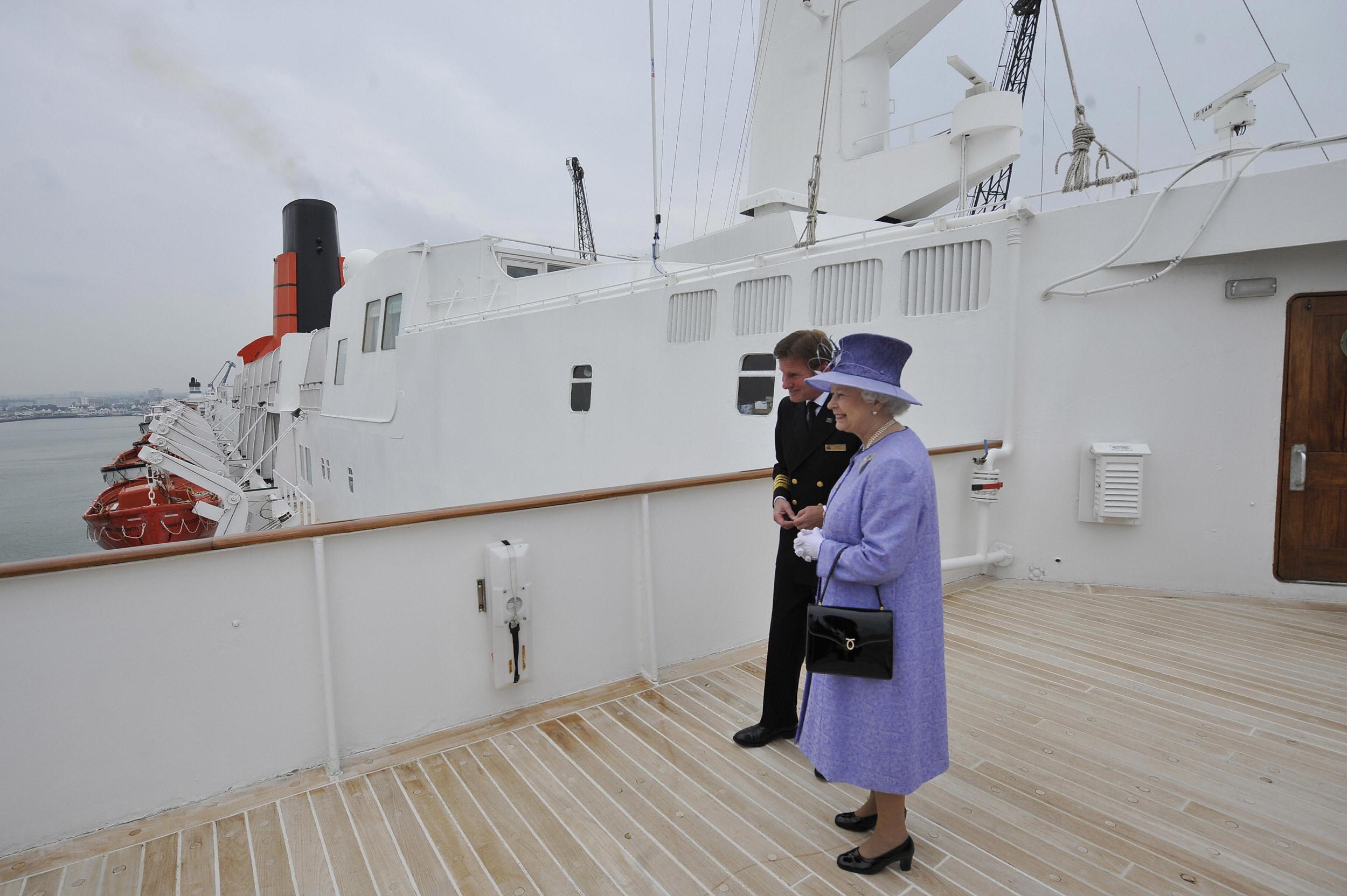 Britain's Queen Elizabeth II (R) is pictured during her visit of the Queen Elizabeth 2