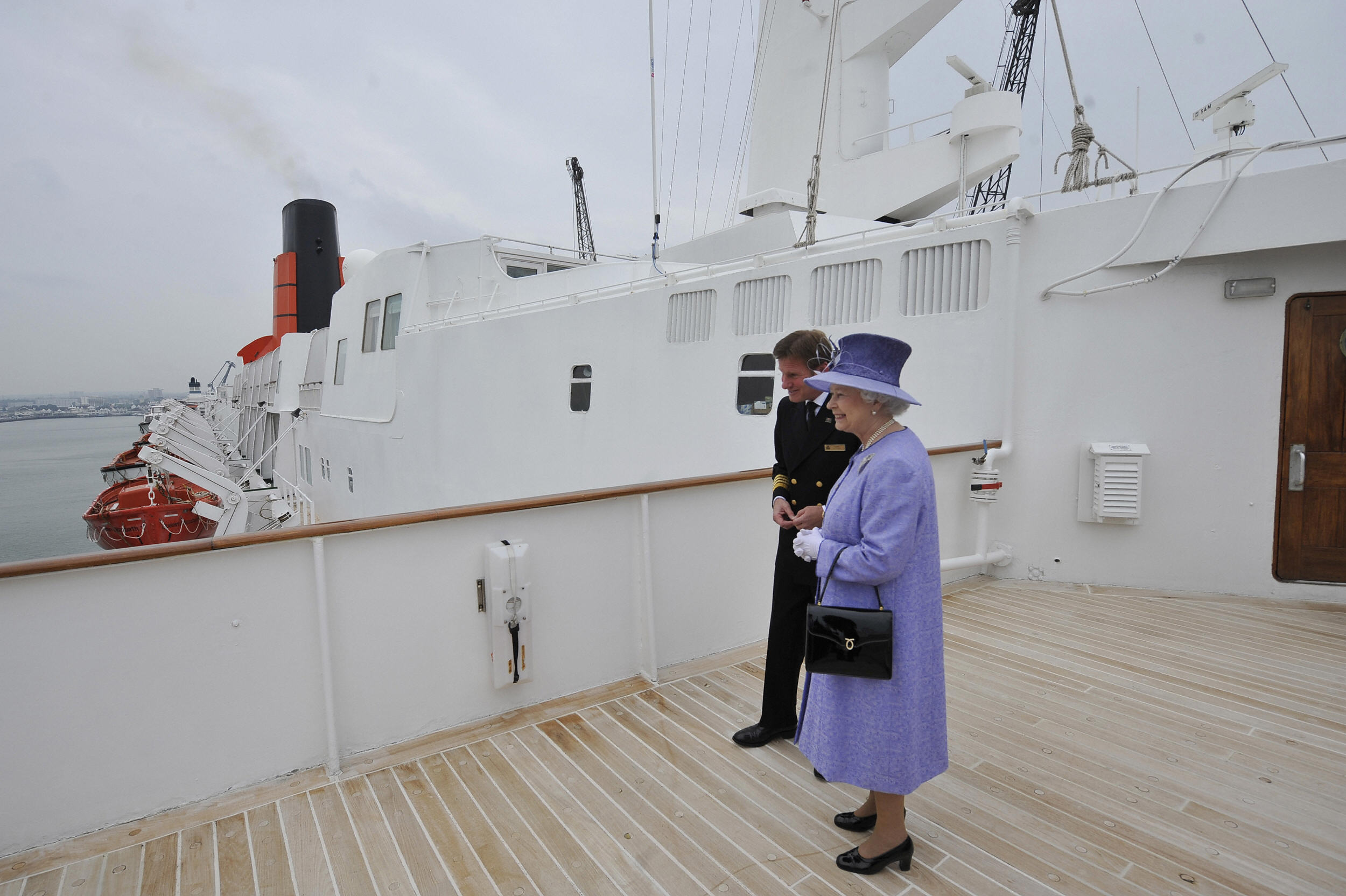 Britain's Queen Elizabeth II (R) is pictured during her visit of the Queen Elizabeth 2