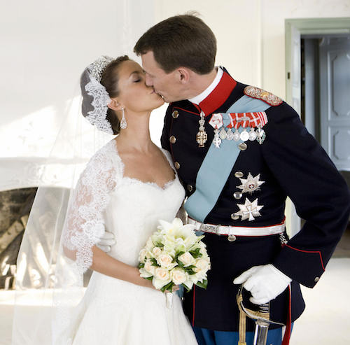 Prince Joachim of Denmark, Queen Margrethe's youngest son, kisses his bride, French Marie Cavallier, now Princesss Marie of Denmark, in this official photo.