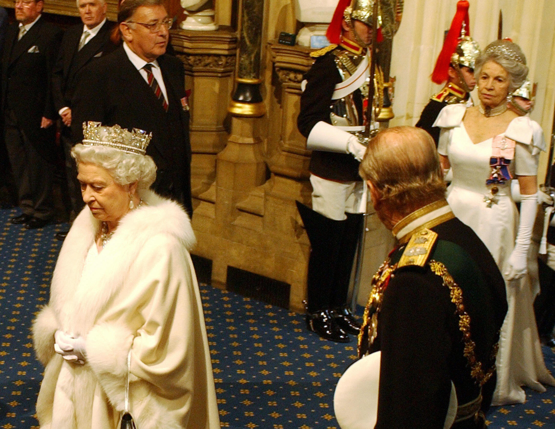 Queen Elizabeth II arrives on the Norman Porch as Prince Phillip looks back to a lady in waiting