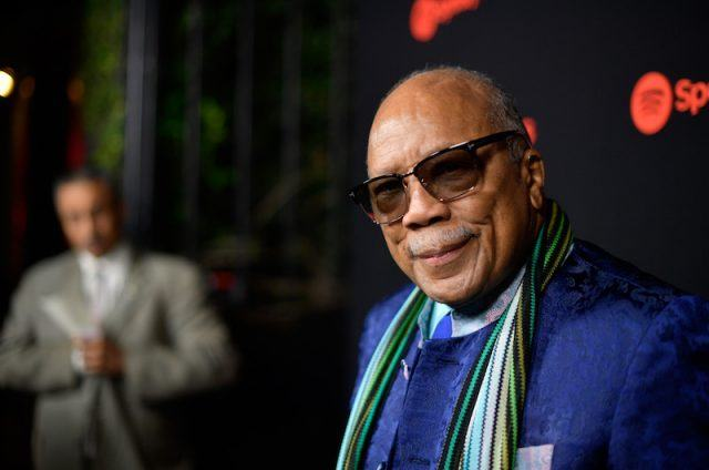 Quincy Jones posing on a red carpet.