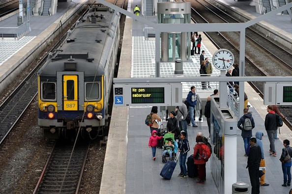 Passengers wait at the Liege-Guillemins railway station during a spontaneous strike