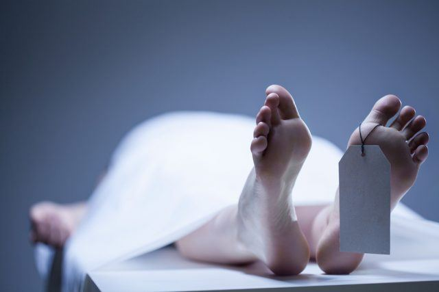 person lying in mortuary