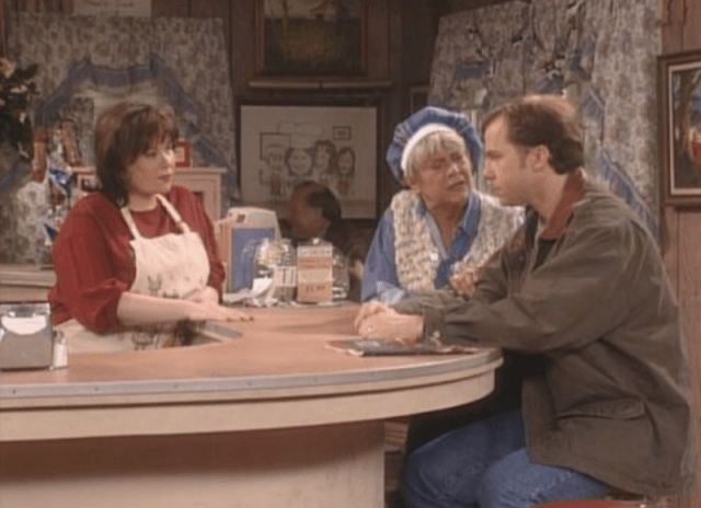 Roseanne behind the counter.