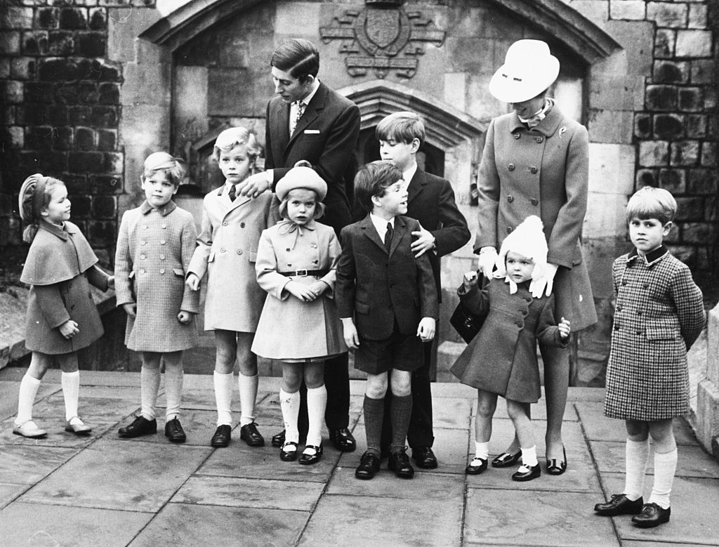 Prince Charles (behind, left), Prince Andrew and Princess Anne (behind, right) arranging a group of Royal grandchildren for a portrait (L-R) Lady Sarah Armstrong-Jones, James Ogilvy, the Earl of St Andrews, Lady Helen Windsor, Viscount Linley, Marina Ogilvy and Prince Edward