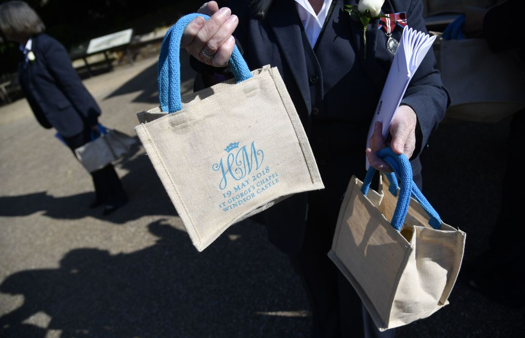 A member of staff holds bags with the wedding monogram ahead of the wedding ceremony of Britain's Prince Harry, Duke of Sussex and US actress Meghan Markle