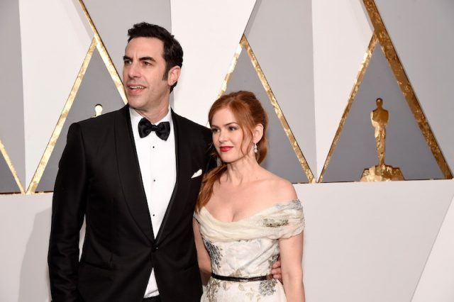 Sacha Baron Cohen and Isla Fisher on a red carpet.