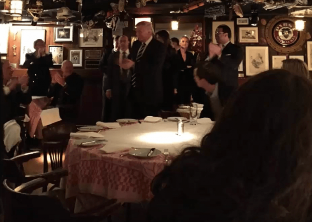 Donald Trump enters the 21 Club restaurant.