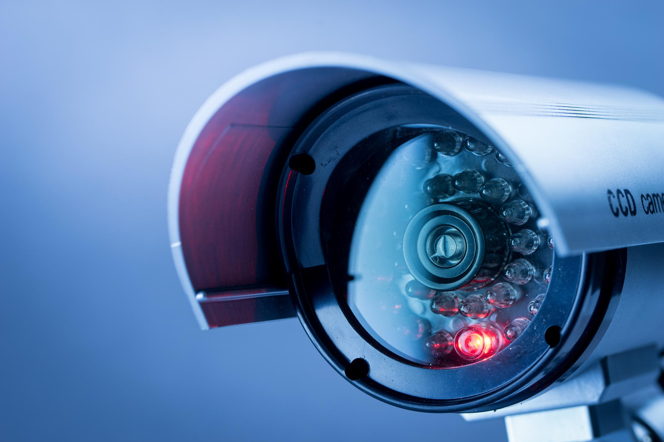 Security, CCTV camera for office building at night in London.