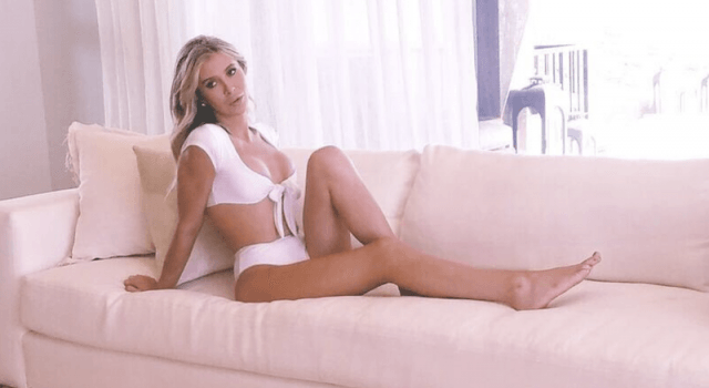 Sophia Hutchinson on a couch.
