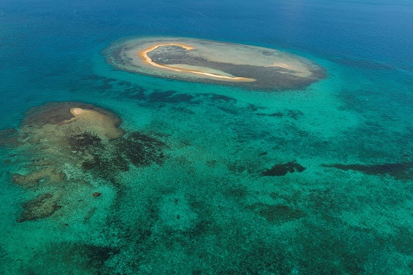An island in the South Pacific surrounded by coral reef