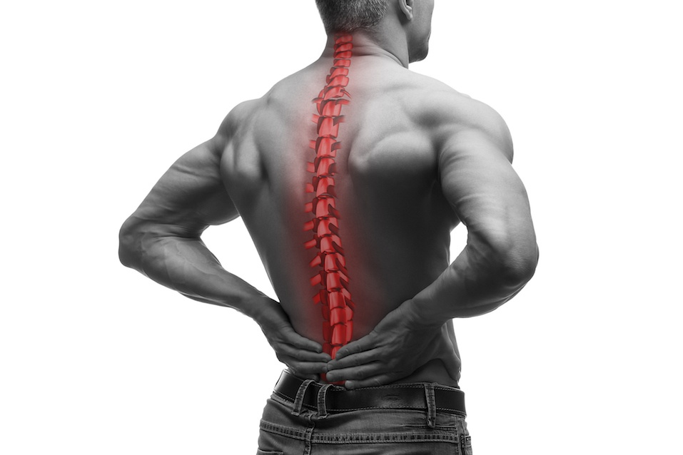 Man holding his lower back with his spine illuminated in red