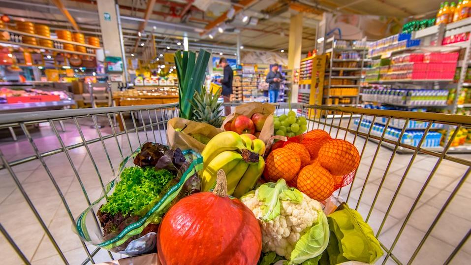 Grocery shop cart in supermarket filled up