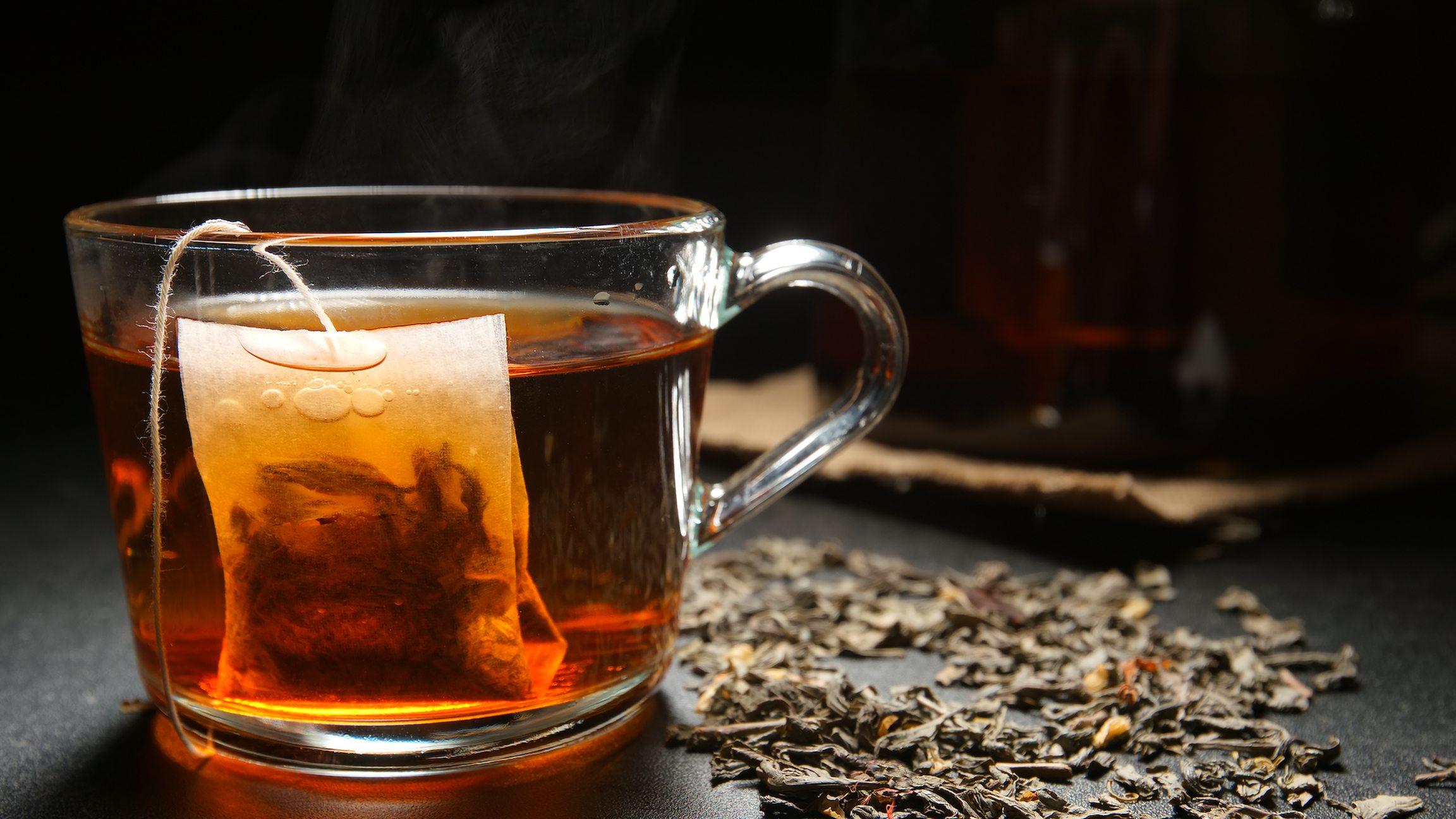 Tea bag in a hot tea cup on a table