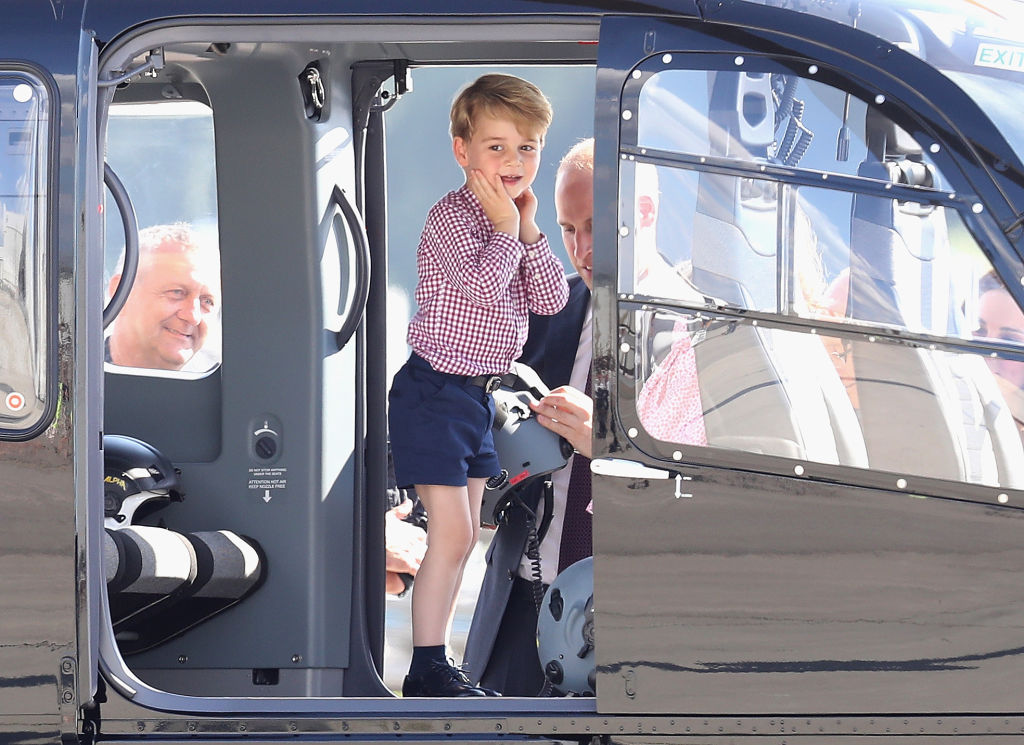 Prince William, Duke of Cambridge, Catherine, Duchess of Cambridge, Prince George of Cambridge and Princess Charlotte of Cambridge view helicopter models H145 and H135
