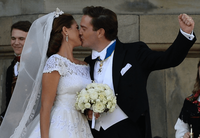 Christopher O'Neill and Princess Madeleine of Sweden kiss on their wedding day.