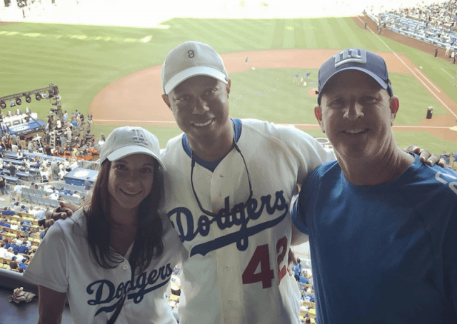 Tiger Woods and Erica Herman at a baseball game.