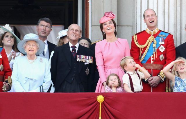 Camilla, Duchess of Cornwall, Prince Charles, Prince of Wales, Queen Elizabeth II, Prince Philip, Duke of Edinburgh, Catherine, Duchess of Cambridge, Princess Charlotte of Cambridge, Prince George of Cambridge and Prince William, Duke of Cambridge look out from the balcony of Buckingham Palace   Does the royal family have a last name? Here's what you need to know