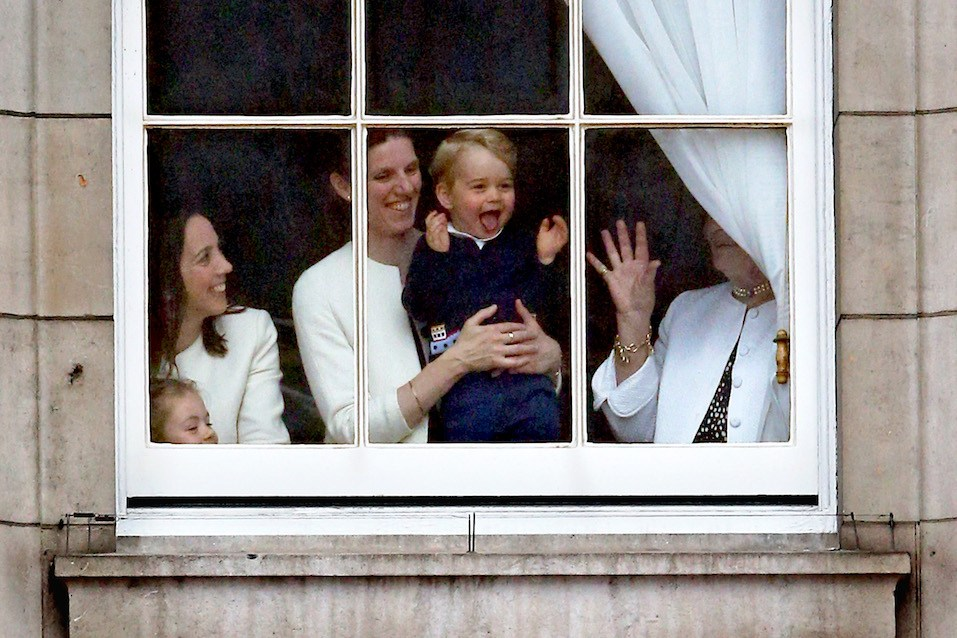 Prince George looks through a window in Buckingham Palace prior to the Trooping The Colour ceremony