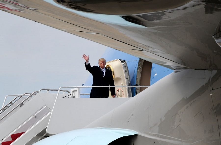 Donald Trump waving on an airplane
