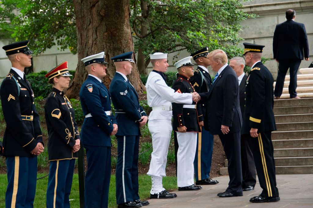 US President Donald Trump shakes hands with members of the military