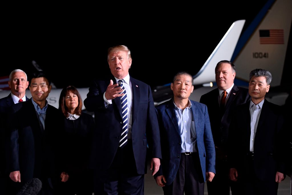Donald and melania trump with the North Korean prisoners