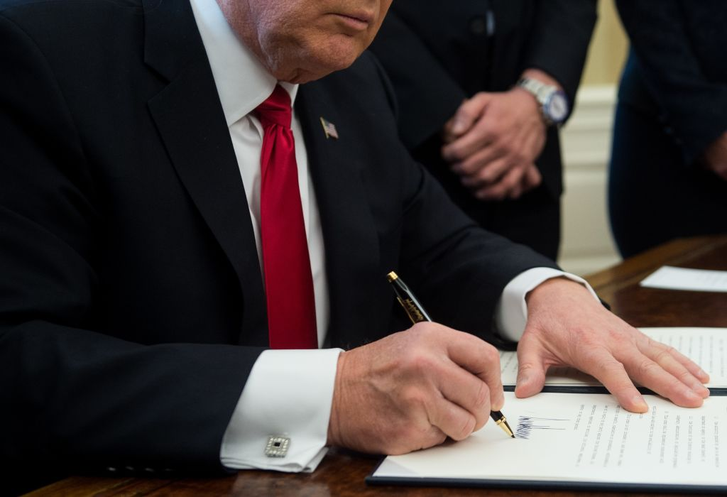 US President Donald Trump signs an executive order with small business leaders