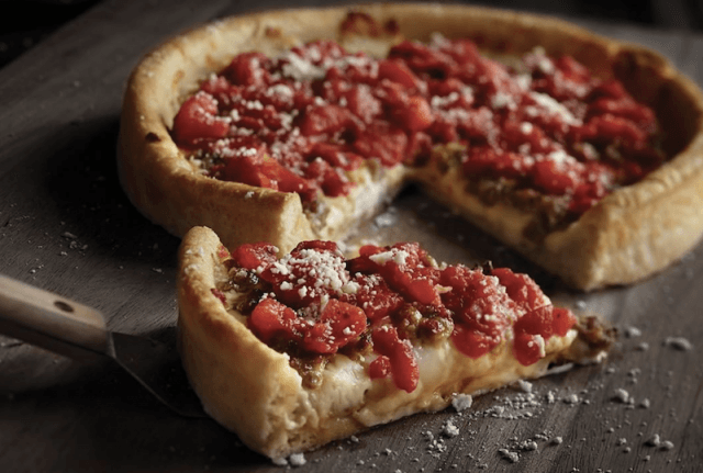 Uno deep dish pizza on a table.